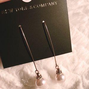 New York & Company rose gold pearl earrings.